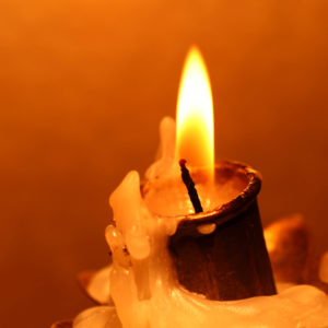 Warmth of candle flame - self care during the holidays